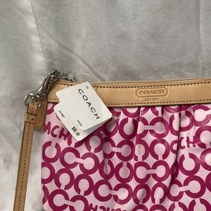 Coach pink wristlet, leather and canvas